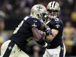 Adrian Peterson (li.) und Drew Brees