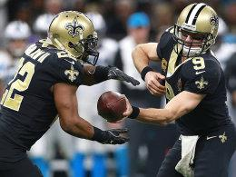 Drew Brees (re.) auf Mark Ingram
